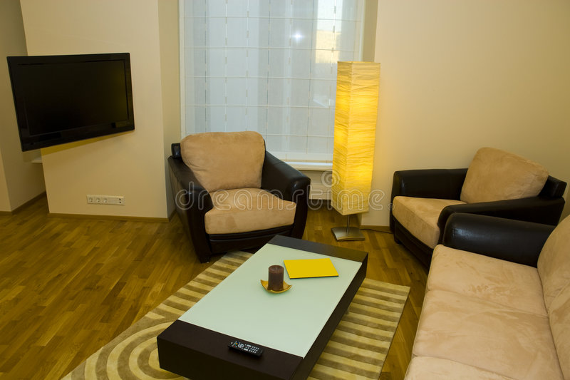 Small modern apartment. With sofa, table and mood lighting royalty free stock photos