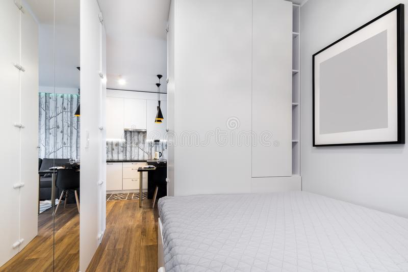 Small modern bedroom interior design. In gray finishing stock images
