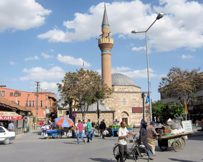 Konya – Small mosque and street life - Turkey. Konya – Small mosque and street life with people – Turkey royalty free stock photos