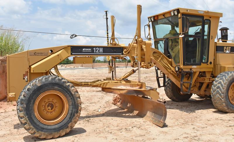 A small motor grader with GPS guidance system stock image