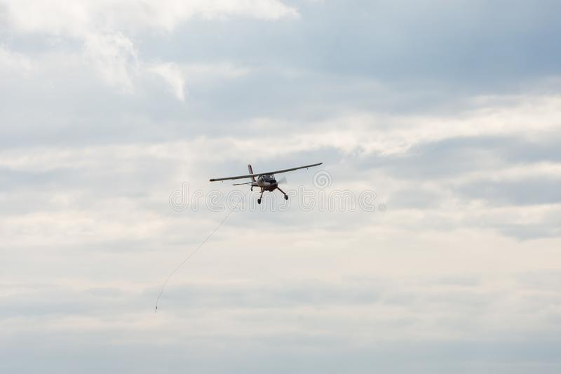 Small motor plane flying in  sky royalty free stock photo