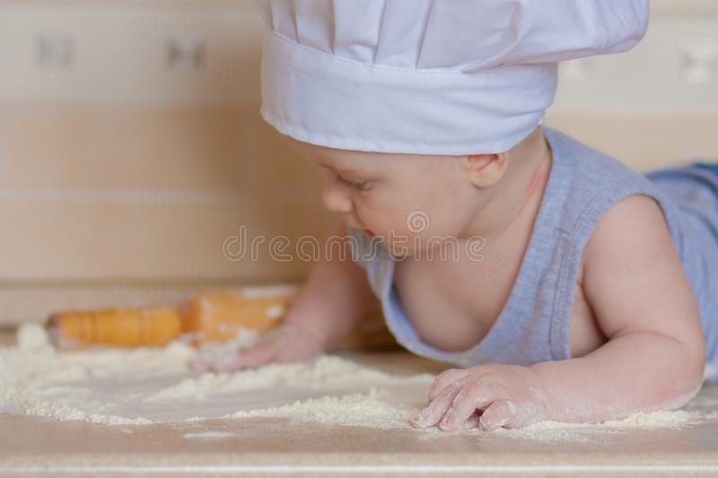 Small motor skills for the child& x27;s. Development of the child through cooking. child and flour stock image