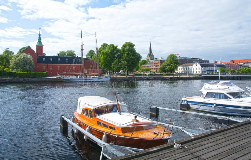 Small motorboats Nissan river Halmstad Sweden. HALMSTAD, SWEDEN - JUNE 7, 2015: Small motorboats moored along the quay by Nissan river with castle behind royalty free stock photography