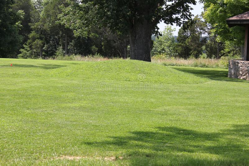 Small mound at the great serpent mound. There were a handful of smaller mounds on the outskirts of Serpent Mound. This Mound was built by the Fort Ancient stock image