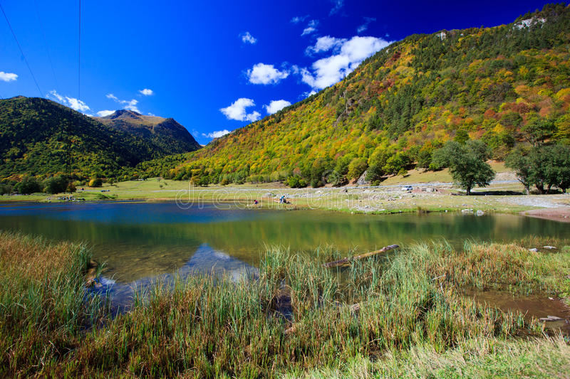 Small mountain lake in beautiful mountains royalty free stock photography