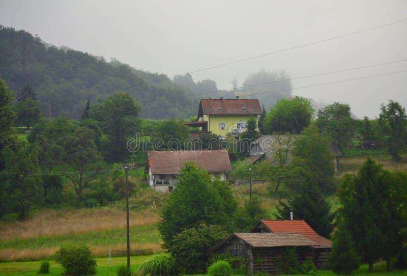 Small mountain picturesque village Slovenia Europe. Small houses of Stari trg Višnja Gora village,Municipality of Grosuplje seen from A2 motorway-Dolenjska stock photography