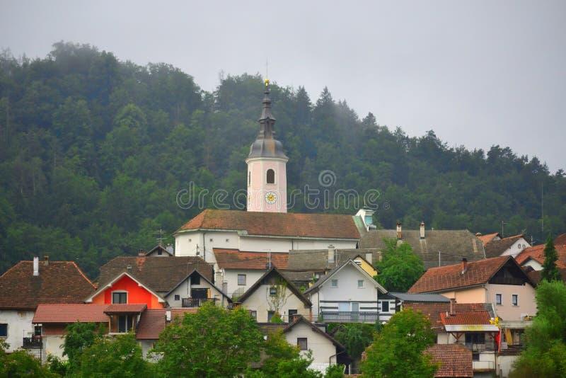 Small mountain picturesque village Slovenia Europe. View of Višnja Gora village of Municipality of Grosuplje seen from A2 motorway-Dolenjska avtocesta on a stock photo