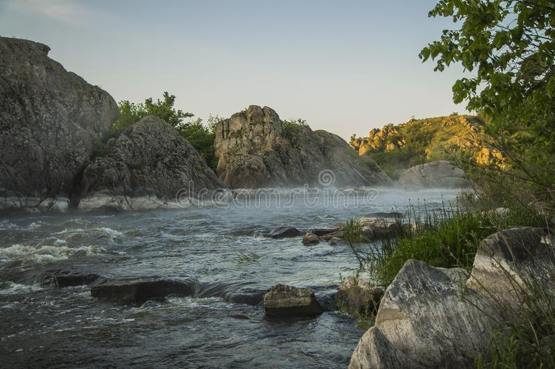 Small mountain river. Landscape with stream flowing between rocks. Water in mountains. River in fog stock photos