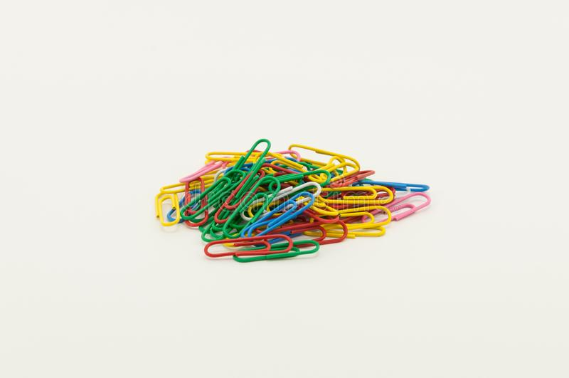Multi-colored paper clips on a white background. stock photography