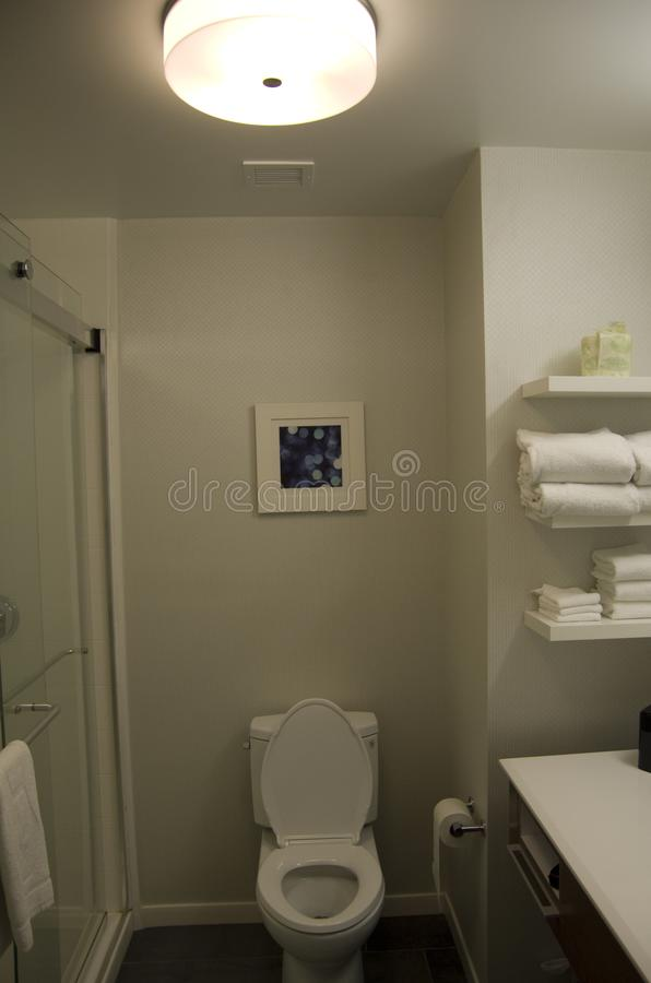 Small neat hotel bathroom design. A new 3 star hotel bathroom with practical design. It is neat and modern stock photos