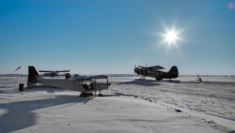 Small north airfield. Picture of small north airfield with planes stock photo