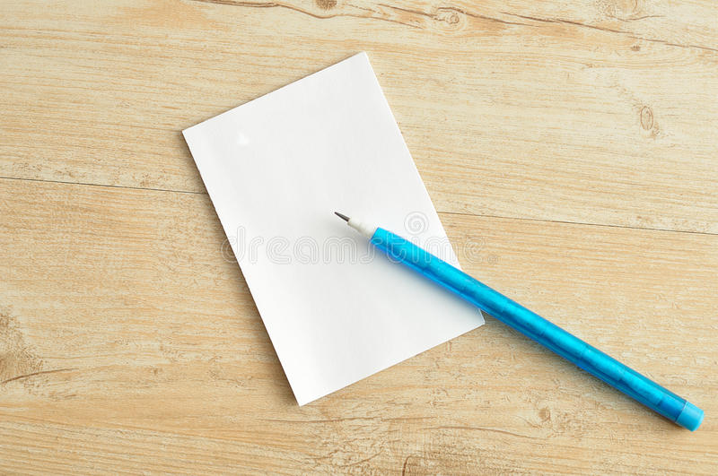 Small note pad with a blue pencil royalty free stock image