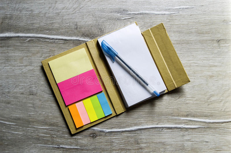 Small note with sticky paper for business people, teachers and students.  royalty free stock image