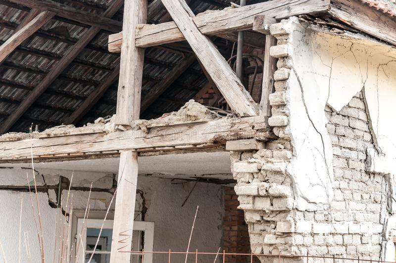 Small old and abandoned house demolished of the earthquake destruction closeup stock images