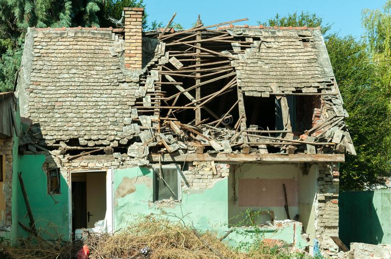 Small old and abandoned house demolished of the earthquake destruction closeup stock photography