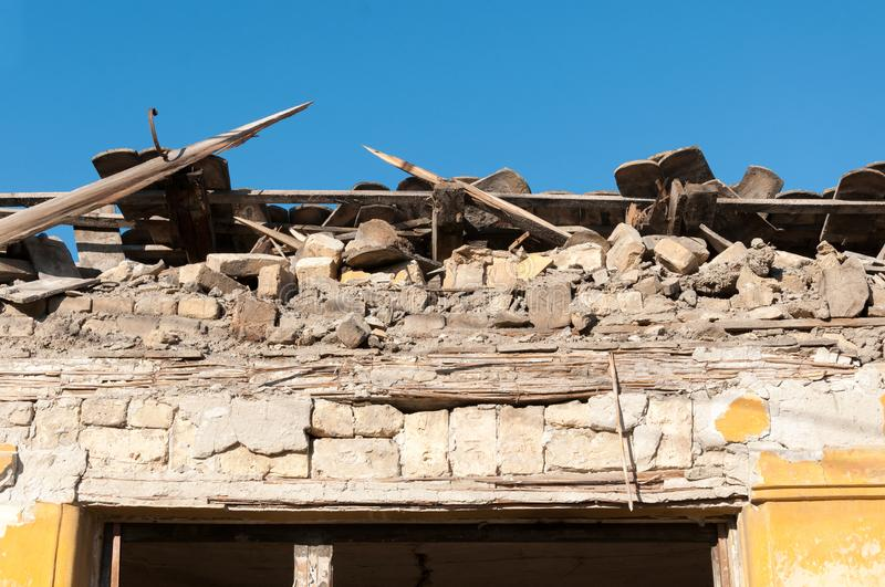 Small old and abandoned house demolished of the earthquake destruction closeup stock photo