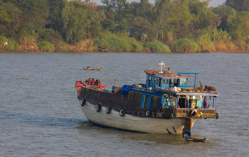 An Small, Old Cargo Ship Along the Mekong royalty free stock photography