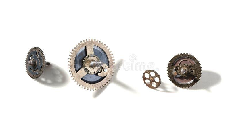 Small old cogwheels. Clockwork cogwheels on a white background royalty free stock photos