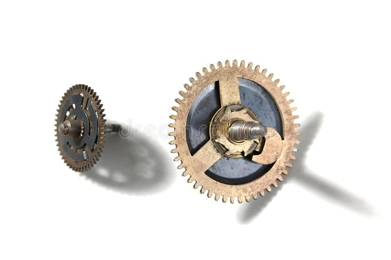 Small old cogwheels. Clockwork cogwheels on a white background stock photography