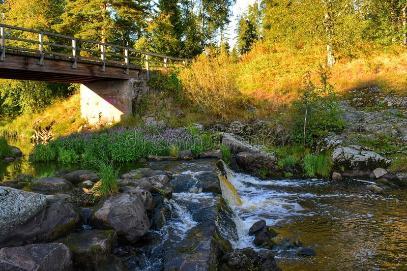 Small old dam. Small waterfall in an old dam royalty free stock photos