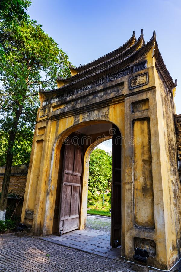 Small Old Gate of the Thang Long Citadel in the imperial city, Hanoi, Vietnam. Small yellow gate of the Thang Long citadel part of the central sector of the royalty free stock image