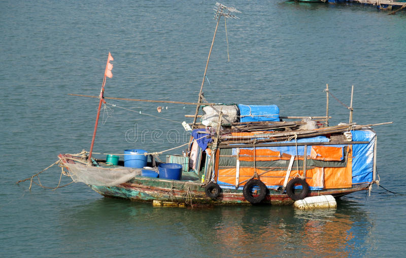 Small old ship in water. Small colorful ship boat in water. fishing boats and small boats in the sea stock photos
