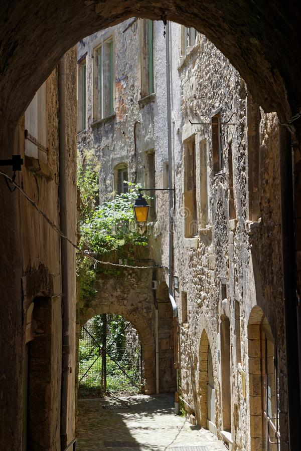 A small old street in Crest. A small old street in the city of Crest, in Drome region stock image