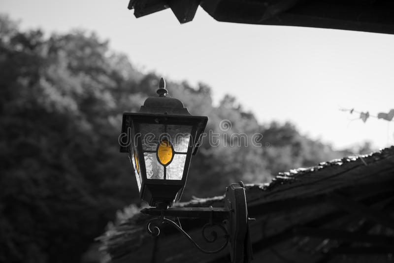 Small old and vintage metal lantern, street lamp. Black and white image. stock photography
