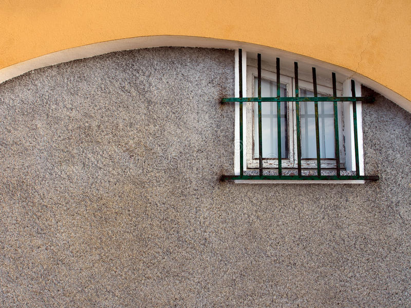 Small old window with security grille, Italy