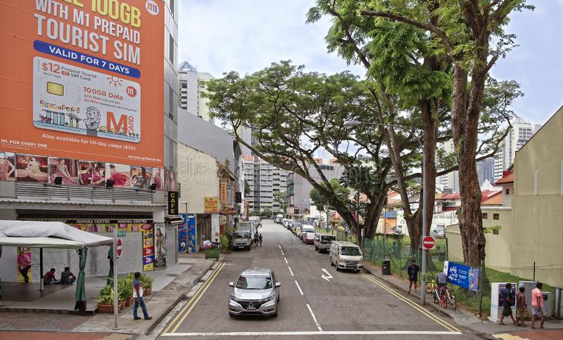 8: Small Open Park on Hindoo Rd. On the street pedestrians and. Singapore, Singapore- August 09, 2018: Small Open Park on Hindoo Rd. On the street pedestrians royalty free stock photography