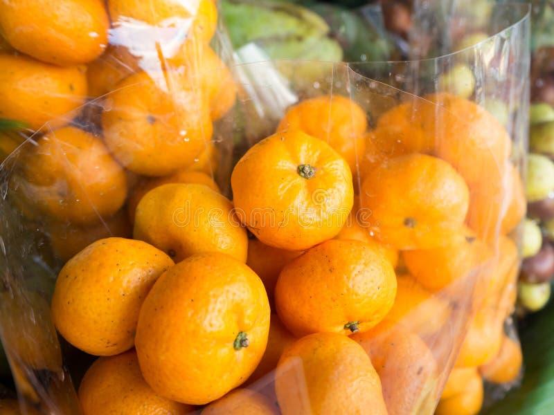 Small orange in plastic bag. stock photo