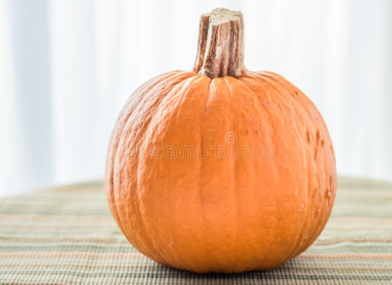 How to use a Pumpkin as a Table Decoration stock photos