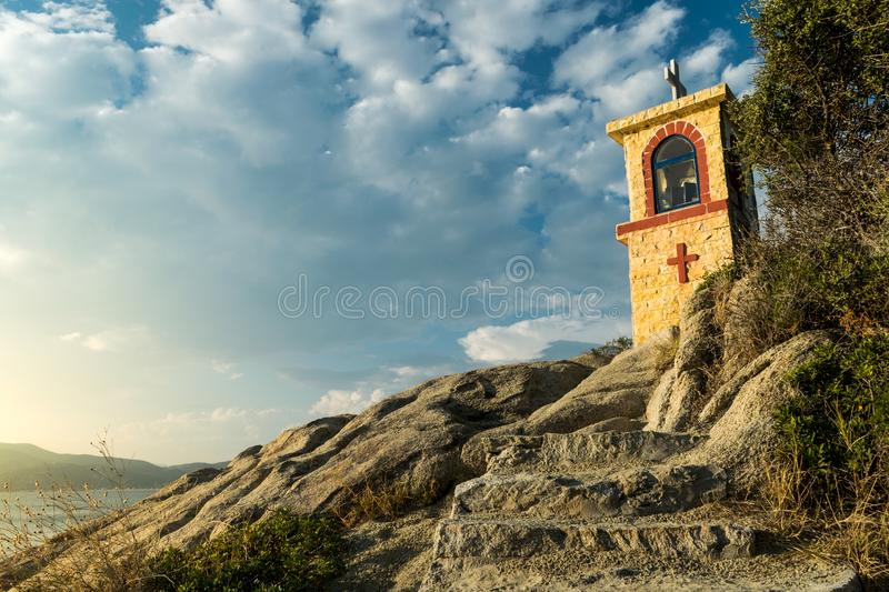 Small orthodox church on sea banks in Greece royalty free stock images