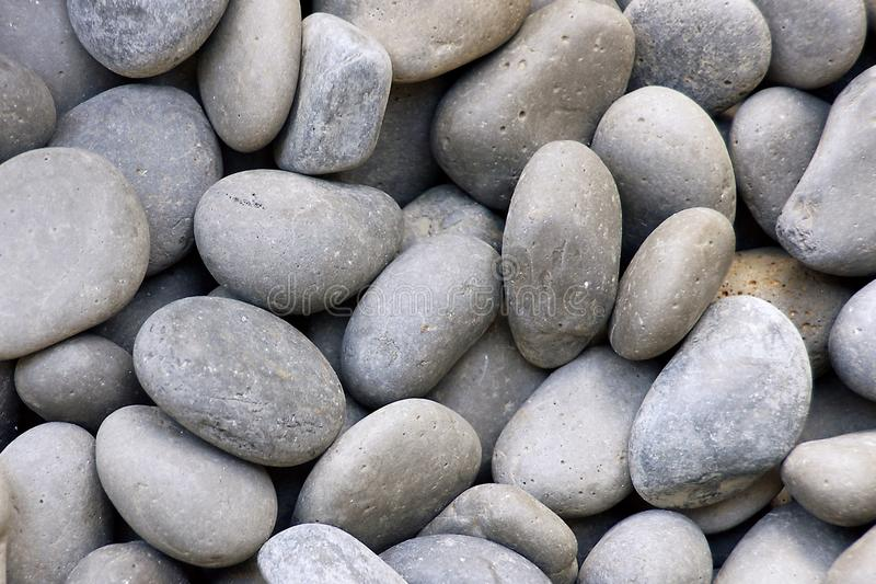 Small oval gray pebbles or stones stock photography