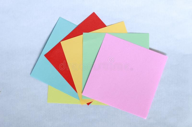 Small paper think self sticky self and all colors to write messages. On withe background stock photo