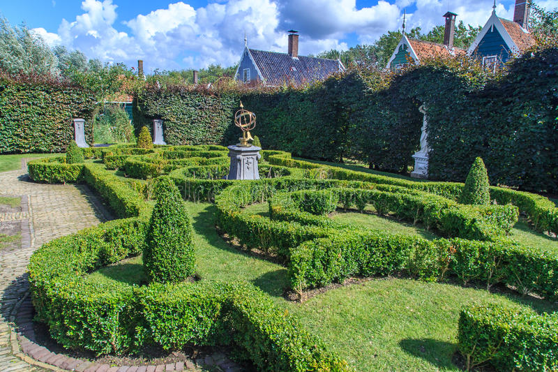 Small park with hedges. And sundial in the middle stock images