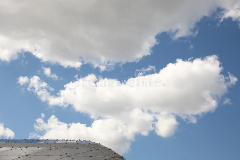 Small part of The roof of the building against the blue sky with clouds. Moscow. 14.08.2015. Small part of The roof of the building against the blue sky with royalty free stock photo