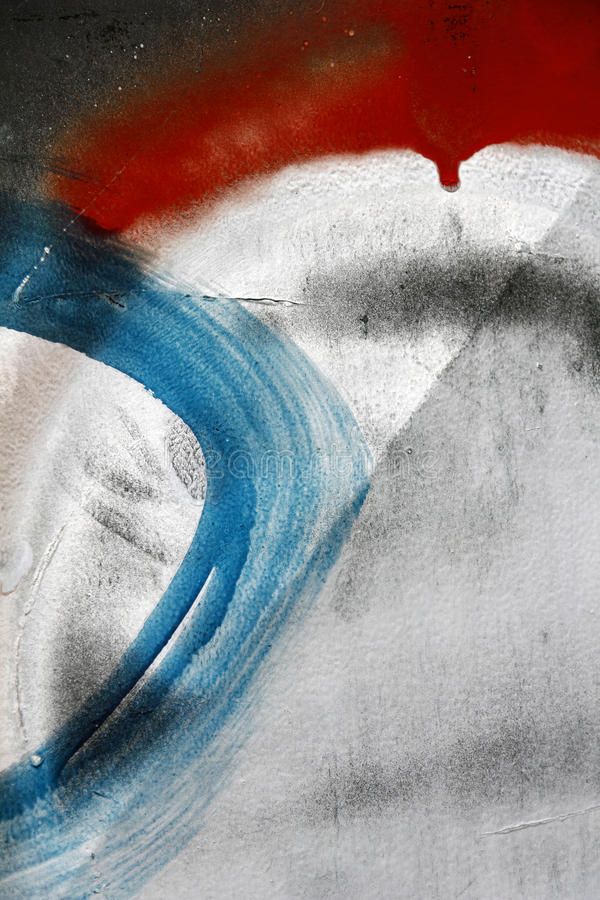 Small part of scratched metal surface painted with black, white. Red and blue paint - Colourful abstract background-Close up 2 royalty free stock images