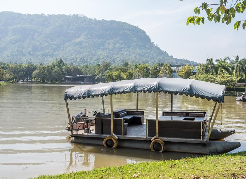 Small passenger boat for travel. Small passenger boat for travel in the lake of the botanical garden,located near the mountain in the national park royalty free stock images