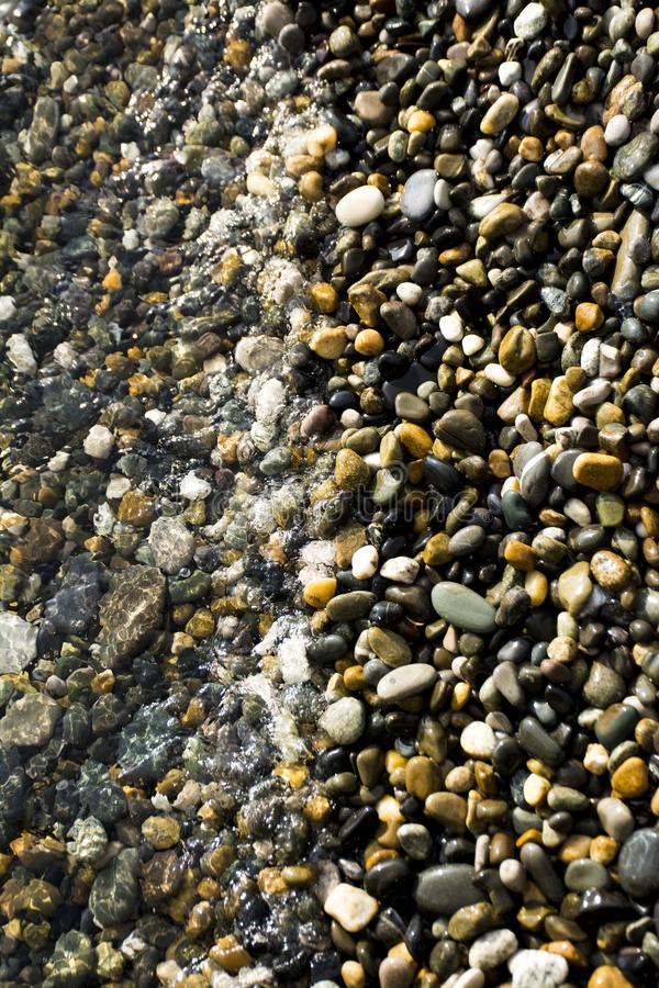 Small pebbles background stock photo