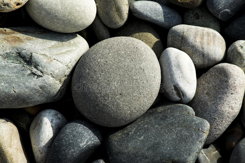 Small pebbles background texture royalty free stock photography