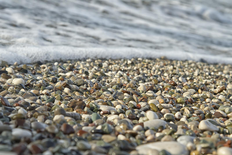 Small pebbles and waves royalty free stock photo