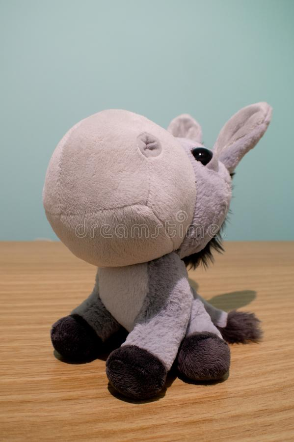 Pelouche donkey. A small pelouche donkey for children to hold and cuddle stock image