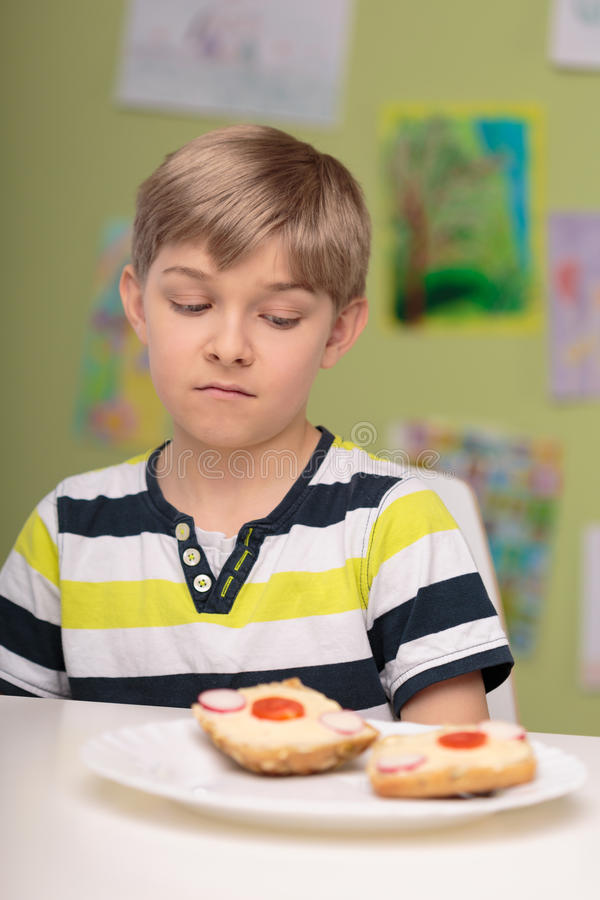 Small picky eater boy. Photo of small picky eater boy dislike healthy breakfast royalty free stock photography