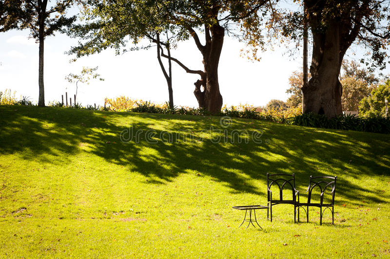 Small picnic table set in green garden royalty free stock photos