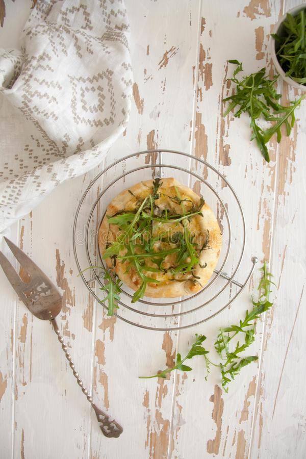 Free Small Pie With Blue Cheese, Pears And Fresh Arugula Royalty Free Stock Photography - 116270657