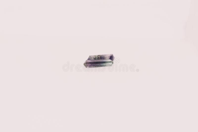 Small piece of fluorite on whit background stock images