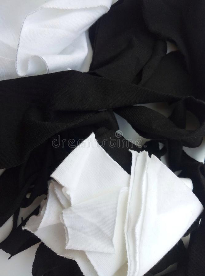 Small pieces of black and white cotton cloth to wipe. Blank, clean, close, closeup, crumpled, cut, detail, duster, element, empty, fabric, fibre, irregular stock photography