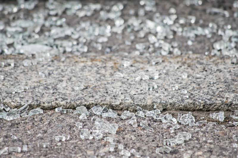 Small pieces of glass on a stone, soft focus. Small pieces of glass on a stone is close, soft focus royalty free stock images
