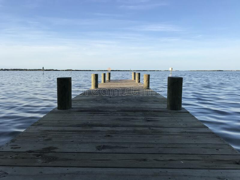Small Pier on River in Cocoa Beach Florida Fishing . Photo image royalty free stock photo